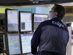 Specialist Patrick King works at his post on the floor of the New York Stock Exchange on Monday, June 18, 2012.