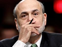Federal Reserve Board Chairman Ben Bernanke testifies on Capitol Hill.