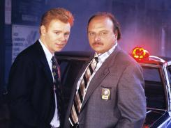 "Early stars of the ABC TV show ""NYPD Blue,"" David Caruso, left, and Dennis Franz."