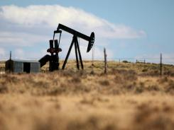 A pumpjack pumps oil at a well in Converse County north of Douglas, Wyo.