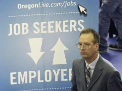 Don Meikle attends a job fair, In Portland, Ore., on April 24, 2012.