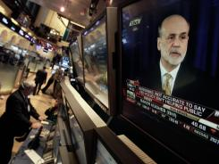 Federal Reserve chairman Ben Bernanke is visible on a television monitor on the floor of the New York Stock Exchange on Wednesday, June 20, 2012.
