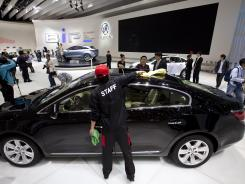 A Buick LaCrosse is prepared for exhibit April 24 at the 2012 Beijing International Automotive Exhibition.