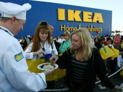 Patrons sample Swedish meatballs while waiting for the doors of a new Ikea store to open in Florida, in this file photo.