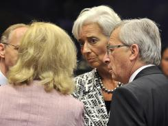 The International Monetary Fund's Christine Lagarde, center, at a Eurozone Council gathering Thursday in Luxembourg.