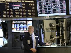 A trader works on the floor of the New York Stock Exchange in New York on Thursday, June 21, 2012.