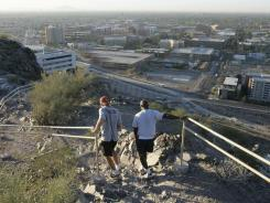 Joggers descend a hill above the main Arizona State University campus in Tempe.