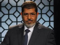 Egypt's president-elect, Muslim Brotherhood leader Mohamed Morsi, gives a speech Sunday in a state TV studio in Cairo.