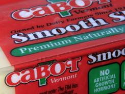 "A package of Cabot cheese bearing the outgoing logo, with the word ""Vermont"" and the shape of the state displayed along with the company name."