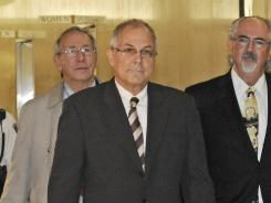 Peter Madoff, center, arrives April 3, 2009, at New York's Supreme Court.