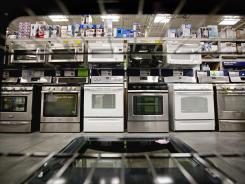 Ovens on display at a Lowe's store June 19, 2012, in Atlanta. Businesses placed more orders with factories for long-lasting manufactured goods in May.