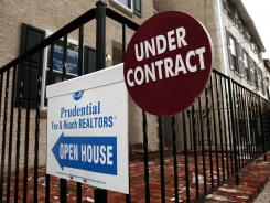 A sign for a home under contract. File photo.