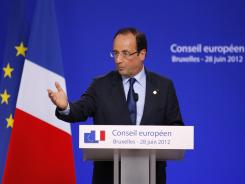 French President Francois Hollande speaks to the media during a press conference at an EU Summit in Brussels on Friday.