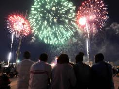 Spectators watch the fireworks show on June 25 in Detroit during the annual Detroit-Windsor freedom festival.
