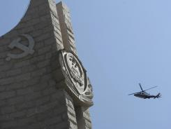 A Chinese police helicopter during the Qingming festival for fallen comrades at the Police Memorial monument in Beijing in April 2012.