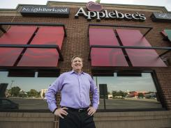Mike Archer, Applebee's CEO, stands outside a restaurant in Mission, Kan.