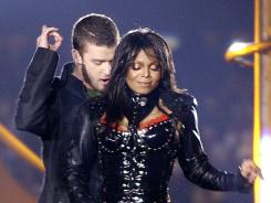 Justin Timberlake and Janet Jackson perform during halftime of Super Bowl XXXVIII in this Feb. 1, 2004 photo. Jackson briefly flashed her breast.