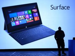 Microsoft CEO Steve Ballmer reveals Surface, a new family of PCs, for Windows on June 18, 2012, in Los Angeles.