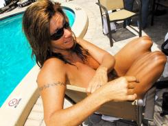 Cindy Wagner of Orlando a enjoys the pool at Fawlty Towers, a clothing optional resort in Cocoa Beach, Fla.