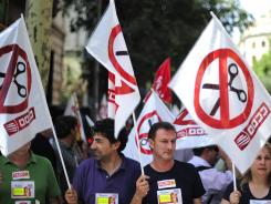 Government employees protest against cuts in Barcelona, Spain, on Thursday, June 28, 2012.