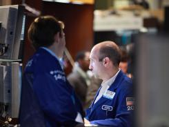 Trading specialist James A. Denaro works the floor of the New York Stock Exchange on June 29, 2012.