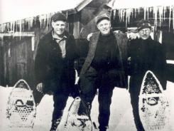 In a 1923 photo from the L.L. Bean Archive, L.L. Bean, left, stands in snow shoes with brothers Otho, center, and Guy.