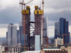 The new headquarters of the European Central Bank, center, rises in front of the skyline of Frankfurt, Germany. The building is scheduled for completion in 2014.