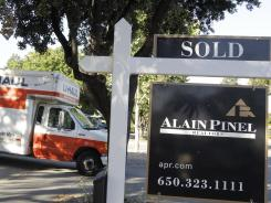 A moving truck at a house that was sold in Palo Alto, Calif., June 19, 2012.