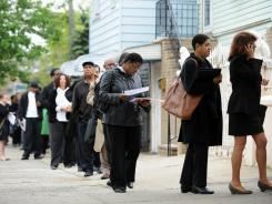 People seeking jobs wait in line to speak to over 60 employers at an employment fair May 3, 2012 in the Queens borough of New York.