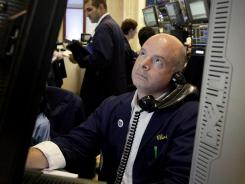 A trader studies his screen as he works on the floor of the New York Stock Exchange on July 3, 2012.