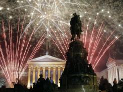 Fireworks over the Philadelphia Museum of Art and a statue of George Washington during Wednesday's Independence Day celebration.