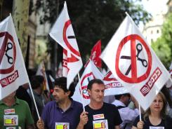 Government employees protest against cuts in Barcelona, Spain, on June 28, 2012.