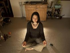 Entrepreneur Wendy Woods, meditating next to her BlackBerry, says it helps her be more creative.