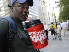 Slurp: Eric Moore sips on a large beverage during a protest in New York City against Mayor Michael Bloomberg's proposed ban on large sugary drinks.