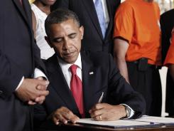President Barack Obama on July 6, 2012, signs into law the bill that reduces what companies are required to contribute to pensions.