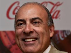 Muhtar Kent, Chairman and CEO of Coca-Cola, poses with a bottle during a press conference in New Delhi June 26, 2012.