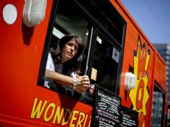 Wendy Cross of Atlanta says $300,000 of the missing money is hers. Here she looks out from her food truck as she waits for the lunch crowd July 10, 2012, in Atlanta.