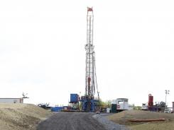 A crew works at a well site for shale-based natural gas on June 25 in Zelienople, Pa.