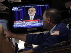 Federal Reserve Chairman Ben Bernanke visible on a television monitor on the floor of the New York Stock Exchange in June 2012.