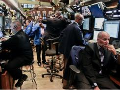 In this Tuesday, July 10, 2012, file photo, traders prepare for the start of early trading at the New York Stock Exchange.