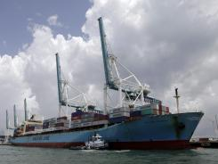 A Maersk freighter is loaded with shipping containers at the Port of Miami in Miami, May 18, 2012.