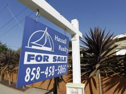 A house is for sale in San Diego in this June 13, 2012, file photo.