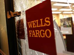 A pipe wrench is embedded in the window of a Wells Fargo bank after an Occupy protester smashed it during a May Day demonstration on May 1, 2012, in Oakland, Calif.