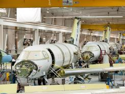 Hawker 4000 business jets sit in various states of assembly in the company's Wichita, Kan. production facility Thursday, Feb. 19, 2009.