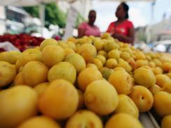 Sugar plums for sale at the Union Square Greenmarket on July 2, 2012 in New York City. Higher produce prices helped push up the wholesale price index in June.