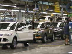 Assembly plant workers build the redesigned 2013 Escape in Louisville, Ky.