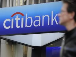 A man walks by a Citibank branch at the US bank Citigroup world headquarters on Park Avenue, in New York, in this November 17, 2008 file photo.