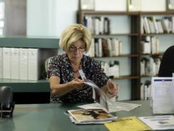 Library clerk Jane Stahl in San Diego, where voters approved rolling back retirement benefits, in June 2012.