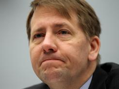 Director of the Consumer Financial Protection Bureau Richard Cordray testifies at a hearing of the House Financial Services Committee March 29, 2012, on Capitol Hill in Washington, D.C.