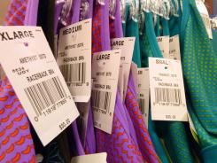 Blouses hang on a rack at a clothing store in North Andover, Mass. in this Monday, June 11, 2012, photo.